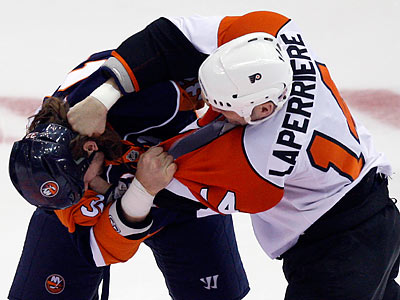Ian Laperriere brawled with the Islanders´ Brendan Witt during the first period of the Flyers´ win. (Seth Wenig/AP)