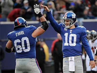 Eli Manning (10) and the Giants needed overtime to get past the Falcons. They´ll take on the Broncos on Thanksgiving night. (AP)