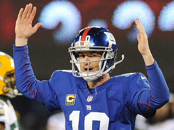 Giants quarterback Eli Manning (10) signals a touchdown during the second half of an NFL football game Sunday, Nov. 25, 2012 in East Rutherford, N.J. After further review Manning´s pass to Hakeem Nicks was ruled a touchdown. (Bill Kostroun/AP)