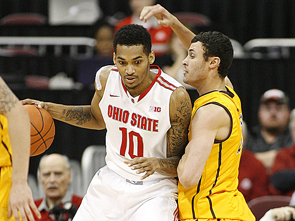 Ohio State´s LaQuinton Ross leans into Wyoming´s Larry Nance, Jr. (Mike Munden/AP)