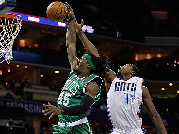 Celtics small forward Gerald Wallace drives to the basket as Bobcats small forward Michael Kidd-Gilchrist defends. (Chuck Burton/AP)