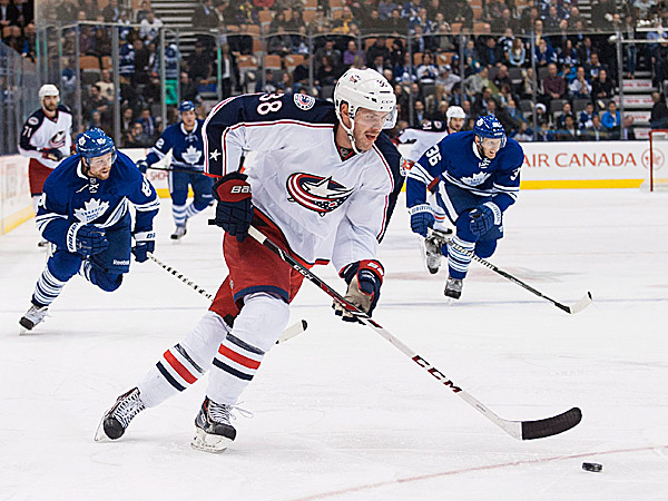 The Blue Jackets´ Boone Jenner takes the puck down the ice. (Aaron Vincent Elkaim/The Canadian Press/AP)
