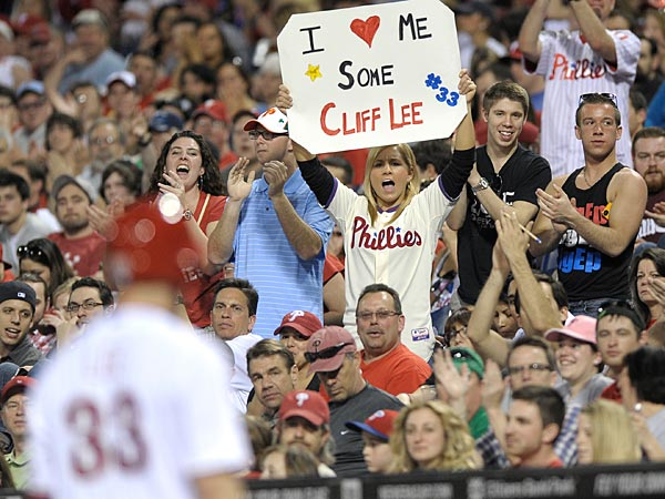We can love Cliff Lee on the road, too. (AP Photo/Michael Perez)