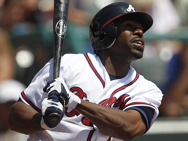 Atlanta Braves&acute; Michael Bourn bats against the New York Mets during a<br />spring training baseball game in Kissimmee, Fla., Monday, April 2,<br />2012. (AP Photo/Paul Sancya)