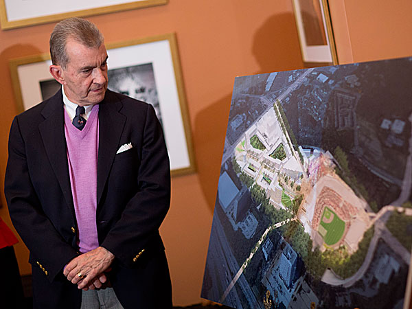 John Schuerholz, Atlanta Braves president, looks at a rendering at a press conference after Cobb County officials approved a deal to build a new $672 million stadium. (David Goldman/AP)
