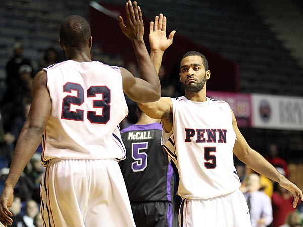 Penn&acute;s Julian Harrell (right) high-fives teammate Greg Louis on a made<br />basket and drawing foul against Niagara during the second half.  (Yong Kim/Staff Photographer)<br />