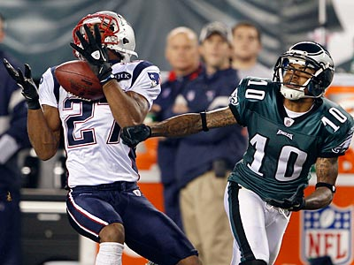 A Vince Young pass intended for DeSean Jackson gets intercepted by the Patriots´ Antwaun Molden. (Yong Kim/Staff Photographer)