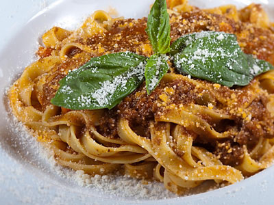 Tagliatelle Bolognese, egg-noodle pasta ribbons, tossed with Bolognese sauce and parmigiano reggiano cheese, as served at Fiorino. (David M Warren / Staff Photographer)