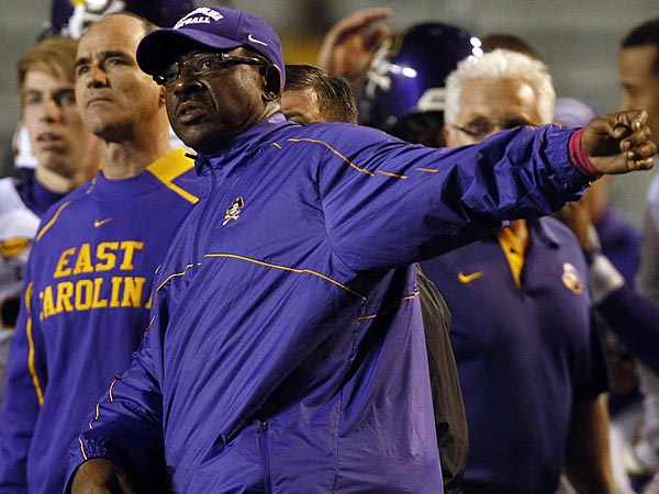 East Carolina coach Ruffin McNeill watches a successful field goal by his team during the first half of an NCAA college football game against UAB on Saturday, Oct. 20, 2012, in Birmingham, Ala. (AP Photo/ Butch Dill)