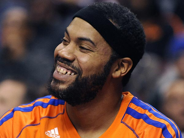 Knicks´ Rasheed Wallace smiles on the bench during an NBA basketball game against the Philadelphia 76ers on Monday, Nov. 5, 2012, in Philadelphia. The Knicks won 110-88. (AP Photo/Michael Perez)