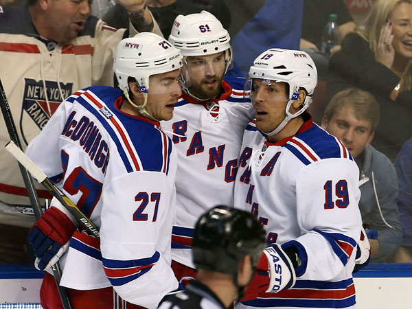 New York Rangers´ Ryan McDonagh (27), Brad Richards (19) and Rick Nash (61) celebrate after Nash scored a goal against the Florida Panthers during the third period of an NHL hockey game in Sunrise, Fla., Wednesday, Nov. 27, 2013. The Rangers won 5-2. (J Pat Carter/AP)