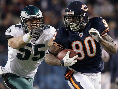 Bears receiver Earl Bennett runs away from Stewart Bradley. (Nam Y. Huh/AP)