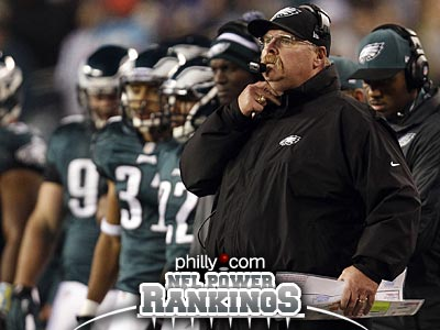 Philadelphia Eagles head coach Andy Reid, right, watches during the third quarter as they play the Carolina Panthers at Lincoln Financial Field in Philadelphia on November 26, 2012. (David Maialetti/Staff Photographer)
