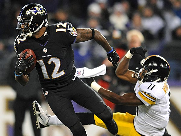 Ravens wide receiver Jacoby Jones rushes the ball past the Steelers´ Markus Wheaton. (Gail Burton/AP)