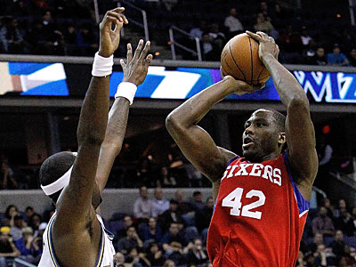 Philadelphia 76ers´ Elton Brand scores over Washington Wizards´ Andray Blatche (7) during their game played on November 24.