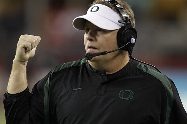 Oregon head coach Chip Kelly calls to his team during an NCAA college football game against Washington State, Saturday, Sept. 29, 2012, in Seattle. (AP Photo/Ted S. Warren)