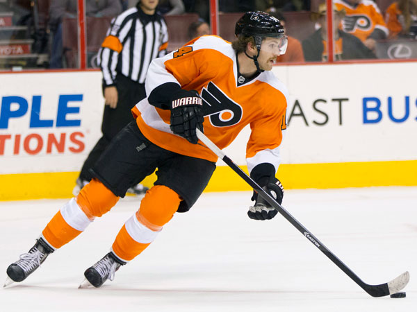Sean Couturier skates with the puck during the first period of an NHL hockey game against the Winnipeg Jets, Friday, Nov. 29, 2013, in Philadelphia. The Flyers won 2-1. (Chris Szagola/AP)