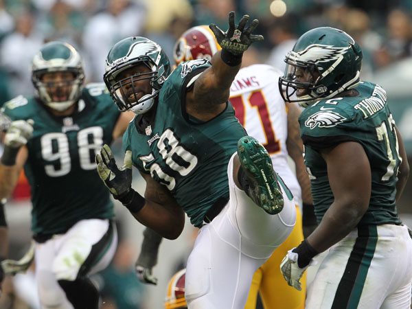 Trent Cole celebrates his second-quarter sack on Washington Redskins´ Robert Griffin III. (Yong Kim/Staff Photographer)