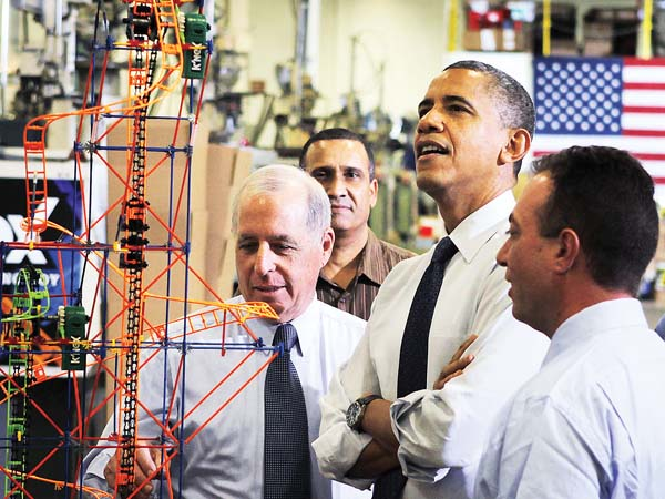 President Obama looks a rollercoaster with from left, K´Nex inventor Joel Glickman,  robotics expert Joao Silver, and chief executive officer Michael Araten and during a visit to th K´Nex factory in Hatfield, Pa. on 11/30/12. ( Michael S. Wirtz / Staff Photographer )