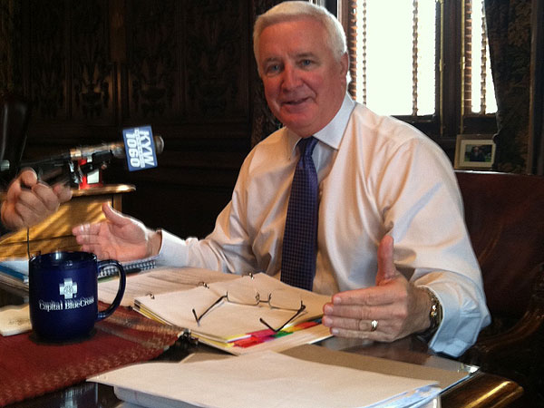 Pennsylvania Gov. Tom Corbett discusses his record and future plans with reporters in his Capitol office. (Amy Worden / Staff)