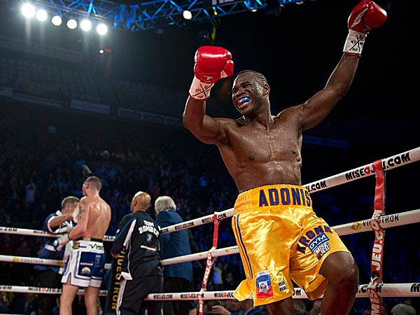Adonis Stevenson celebrates his victory against Tony Bellew. (Jacques Boissinot/The Canadian Press/AP)