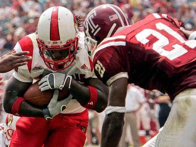 The Temple Owls will face off against the Louisville Cardinals at noon on Saturday. (George Widman/AP file photo)