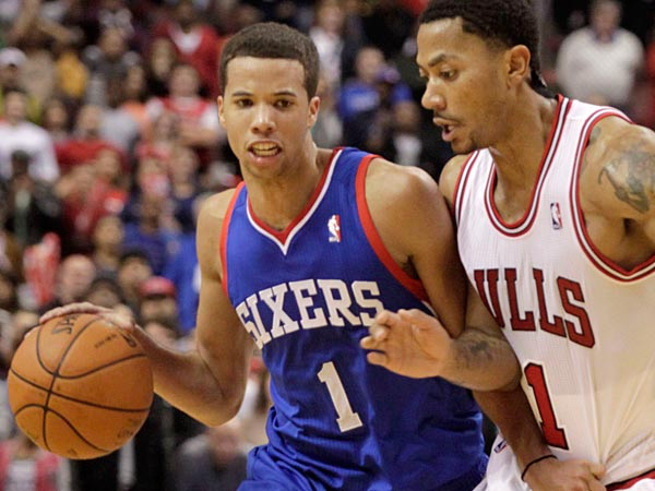 Chicago Bulls´ Derrick Rose, right, defends as Philadelphia 76ers´ Michael Carter-Williams (1) moves the ball up the court in the second half of an NBA basketball game Saturday Nov. 2, 2013, in Philadelphia. The 76ers won 107-104. (AP Photo/H. Rumph Jr)