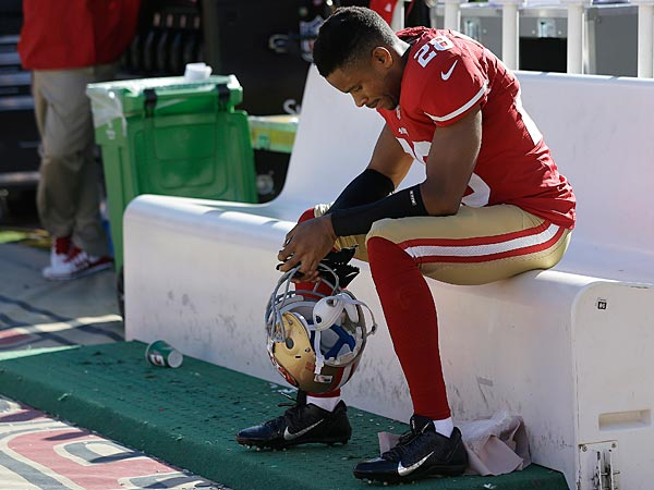 San Francisco 49ers cornerback Nnamdi Asomugha (28) sits on the bench during the fourth quarter of an NFL football game against the Indianapolis Colts in San Francisco, Sunday, Sept. 22, 2013. The Colts won 27-7. (AP Photo/Marcio Jose Sanchez)