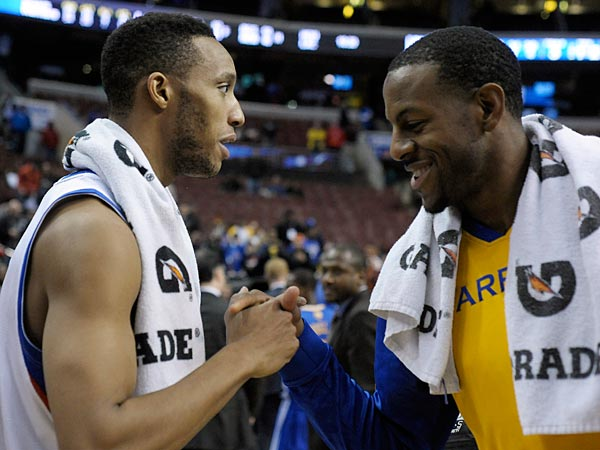 Golden State Warriors&acute; Andre Iguodala, left, greets Philadelphia<br />76ers&acute; Evan Turner at the end of the second half of an NBA basketball game on Monday, Nov. 4, 2013, in Philadelphia. The Warriors won 110-90. (Michael Perez/AP)