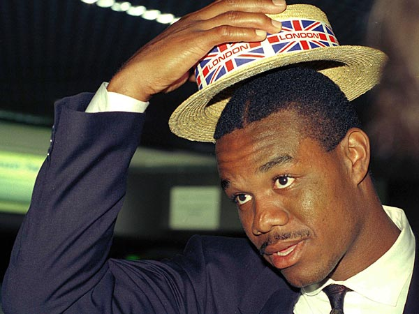 Randy Cunningham, star quarterback of the Philadelphia Eagles tries on a souvenir hat given to him by a fan after his arrival at London's Heathrow Airport on July 31, 1989. The Eagles play the Cleveland Browns next Sunday in an American football game at Wembley Stadium, London. (AP Photo)