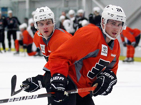 Flyers&acute; Matt Read (right) and Scott Laughton skate during training<br />camp at the Flyers Skate Zone in Voorhees , NJ on Sunday, January 13,<br />2013.  (Yong Kim/Staff Photographer)
