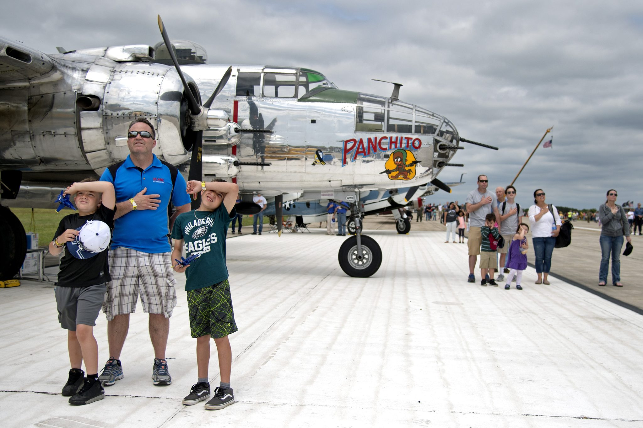 In front of a 1944 B-25J Bomber, John Andrie of Franklinville and his sons Breaden, 7) and Peyton, 8, stand for the National Anthem at start of the Memorial Day Millville Wheels and Wings Air Show May 28, 2017, hosted by and to benefit the Millville Army Air Field Museum.