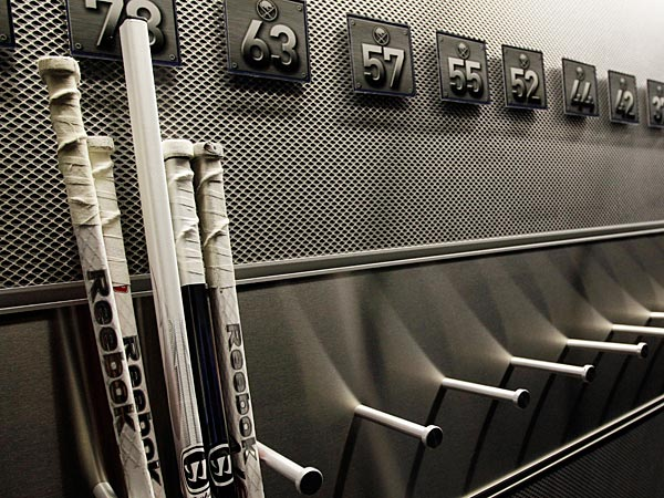 In this Sept. 25, 2012 file photo, a nearly empty hockey stick rack in the locker room of the Buffalo Sabres hockey team is shown during the NHL labor lockout in Buffalo, N.Y.  (AP Photo/David Duprey)