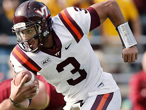 Virginia Tech quarterback Logan Thomas runs against Boston College during the first half of a college football game at Alumni Stadium in Boston, Saturday, Nov. 2, 2013. (AP Photo/Winslow Townson)