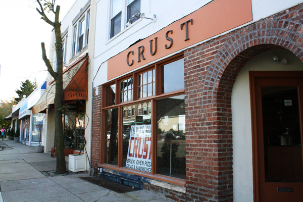 The exterior of Crust, a new restaurant by chef Tony Alidjani, advertises brick-oven pizza, salads and sandwiches.