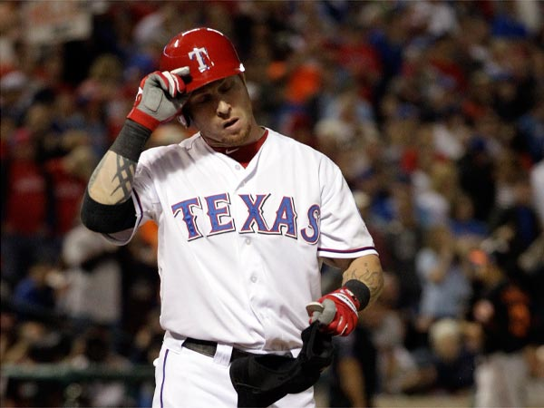 Texas Rangers Josh Hamilton takes off his helmet after striking out in the eighth inning against the Baltimore Orioles in the American League wild-card playoff baseball game Friday, Oct. 5, 2012 in Arlington, Texas. The Orioles won 5-1. (AP Photo/Tony Gutierrez)
