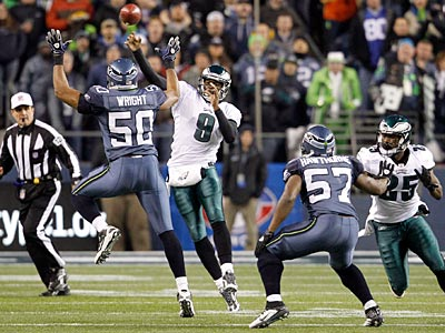 Vince Young threw an interception on the first snap of Thursday night´s game against the Seahawks. (Ron Cortes/Staff Photographer)