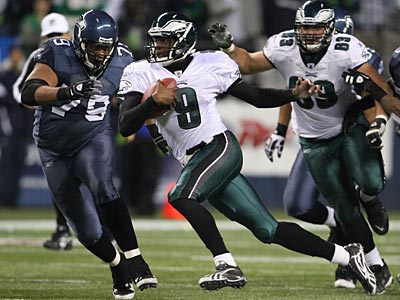 Eagles quarterback Vince Young scrambles against the Seahawks on Thursday night. (Yong Kim/Staff Photographer)