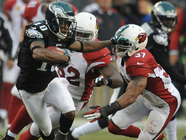 DeSean Jackson stiff-arms Cardinals safety Yeremiah Bell during a punt return. (Clem Murray/Staff Photographer)