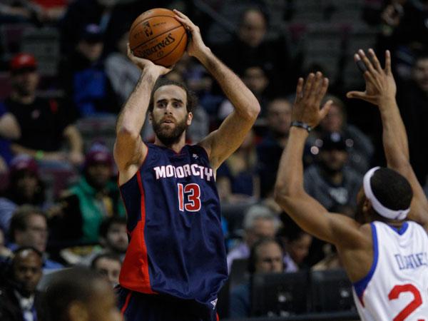 Pistons forward Luigi Datome (13), of Italy, takes a shot against the Philadelphia 76ers. (Duane Burleson/AP)