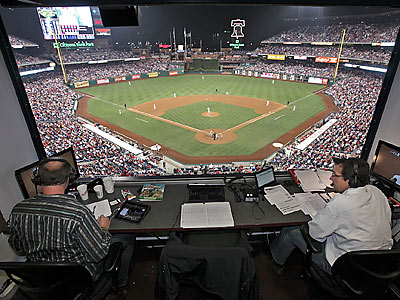 Larry Anderson, left, and Scott Franzke, right, broadcast a Phillies game. (Steven M. Falk/Staff Photographer)