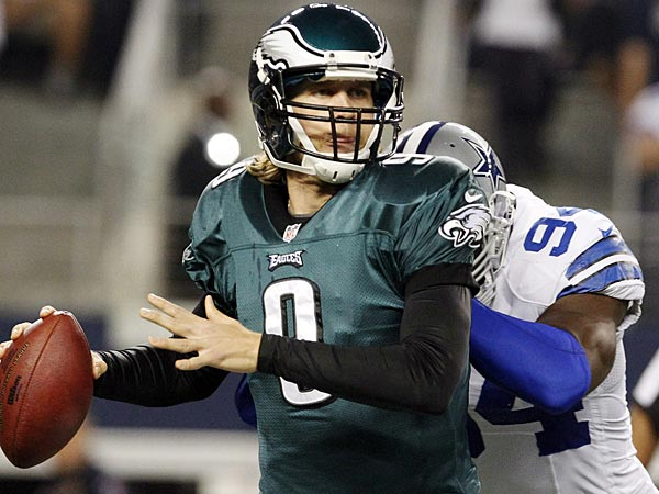 Philadelphia Eagles quarterback Nick Foles (9) is hit by Dallas<br />Cowboys outside linebacker DeMarcus Ware (94) during the first half of<br />an NFL football game, Sunday, Dec. 2, 2012, in Arlington, Texas. (AP<br />Photo/LM Otero)