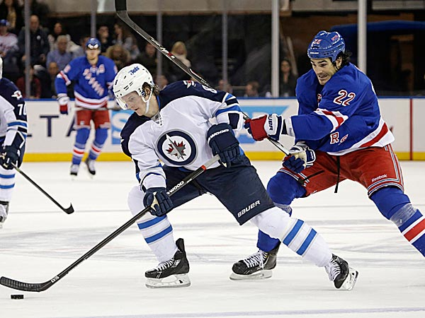 Rangers center Brian Boyle defends Jets defenseman Jacob Trouba. (Kathy Willens/AP)