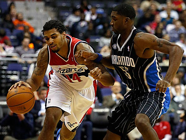 Wizards guard Glen Rice Jr. drives against Magic guard E´Twaun Moore. (Alex Brandon/AP)