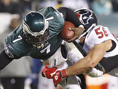 Michael Vick gets hit by the Texans Amobi Okoye in the second quarter. (David Maialetti / Staff Photographer)