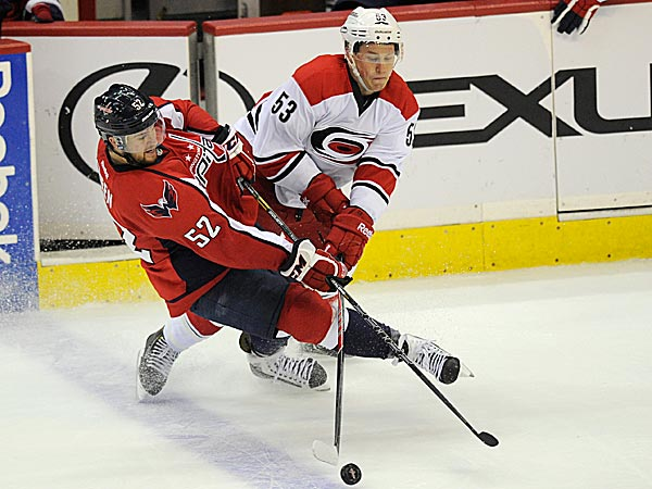 Capitals defenseman Mike Green battles for the puck against Hurricanes center Jeff Skinner. (Nick Wass/AP)