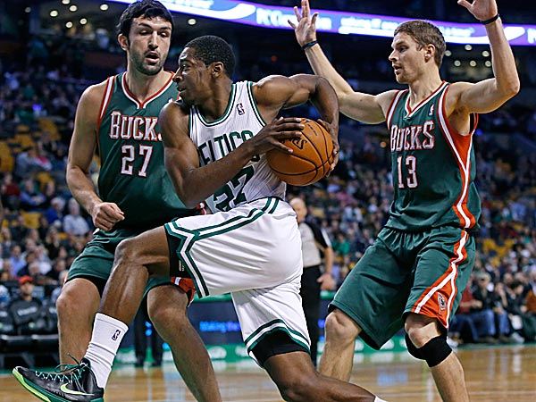 Celtics guard Jordan Crawford drives against Bucks center Zaza Pachulia and point guard Luke Ridnour. (Elise Amendola/AP)