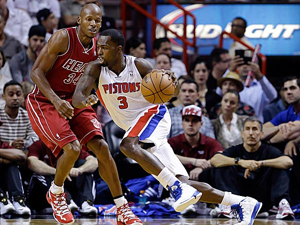 The Pistons´ Rodney Stuckey drives to the basket as the Heat´s Ray Allen  defends. (Lynne Sladky/AP)