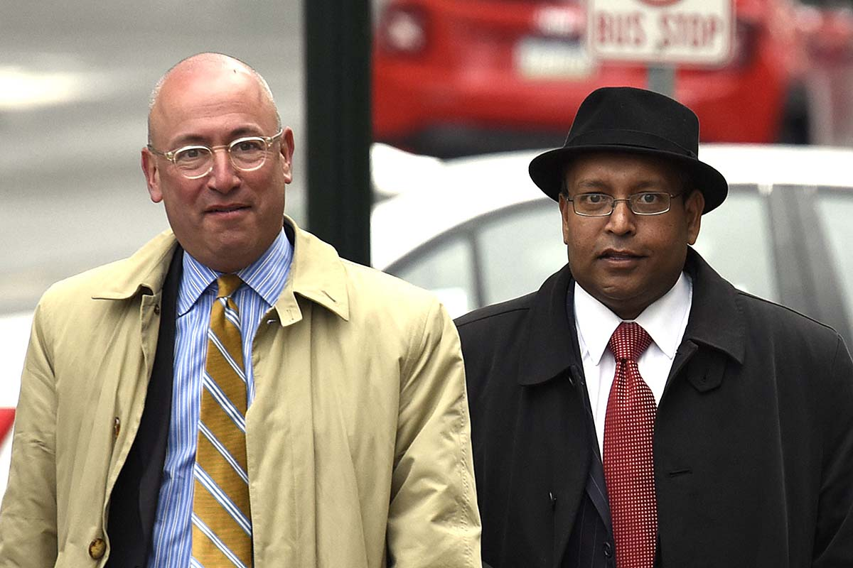 Tyrone B. Ali, right, along with attorney Alan J.Tauber, left,  arrive at the Dauphin County Court house for a hearing Monday, March 28, 2016 in Harrisburg, Pa.