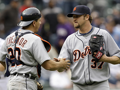 Brandon Lyon, right, shares congratulations with catcher Matt Treanor while playing for the Detroit Tigers. (AP Photo/Elaine Thompson)